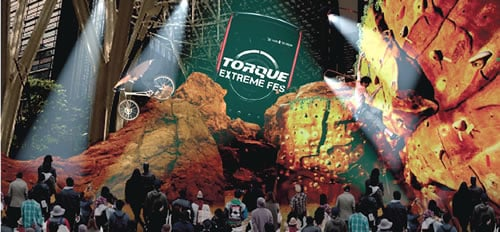 東京ミッドタウンに高さ7メートルの岩山出現! 高耐久性スマホ『TORQUE』発売記念でエクストリームスポーツの祭典開催へ